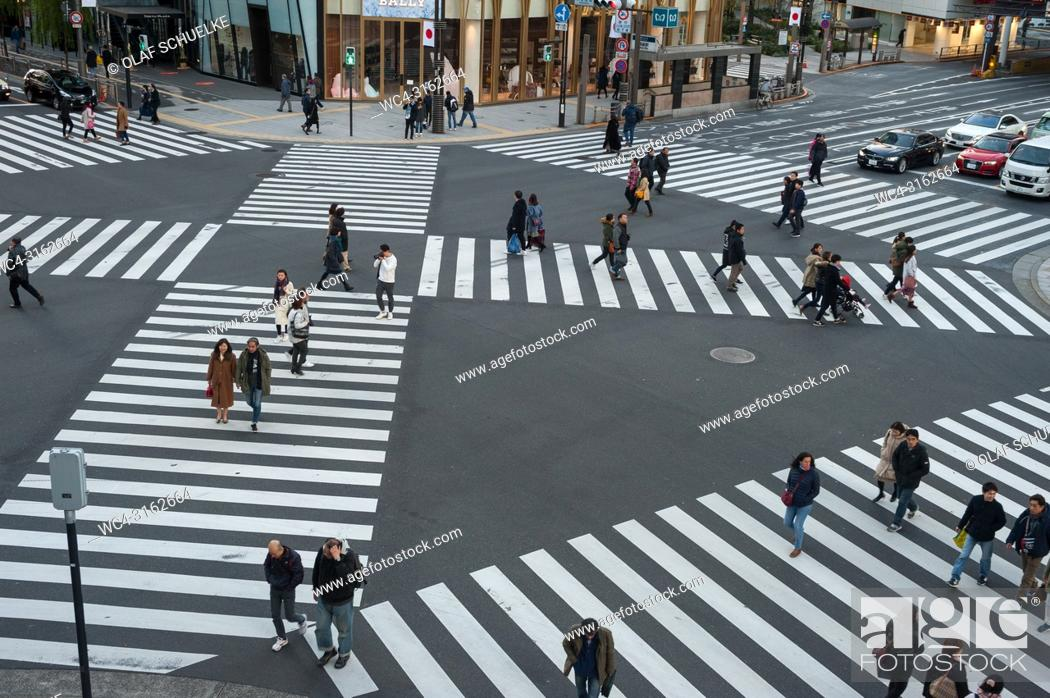 Stock Photo: 01. 01. 2018, Tokyo, Japan, Asia - A pedestrian crossing in Tokyo's Ginza district.