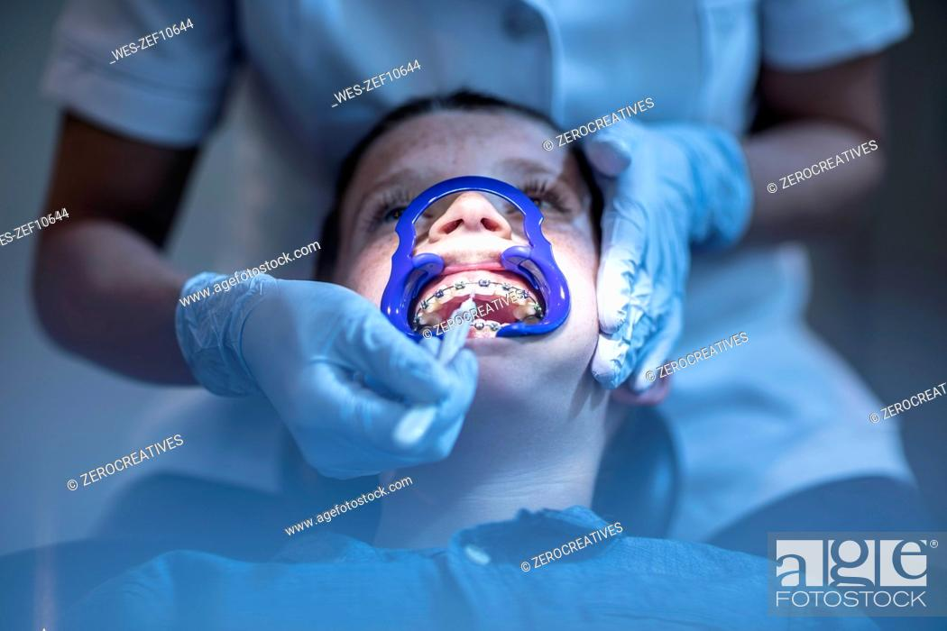 Stock Photo: Boy in dental surgery receiving orthodontic treatment.