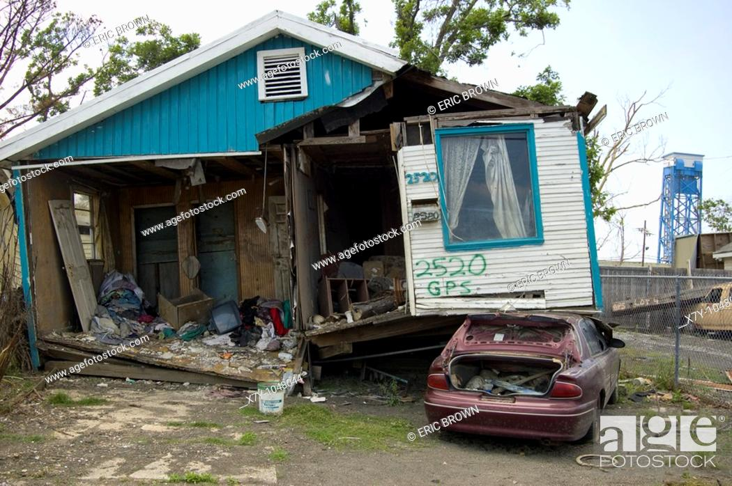Stock Photo: A home sits atop a car 9 months after Hurricane Katrina, in the Lower Ninth Ward, New Orleans.
