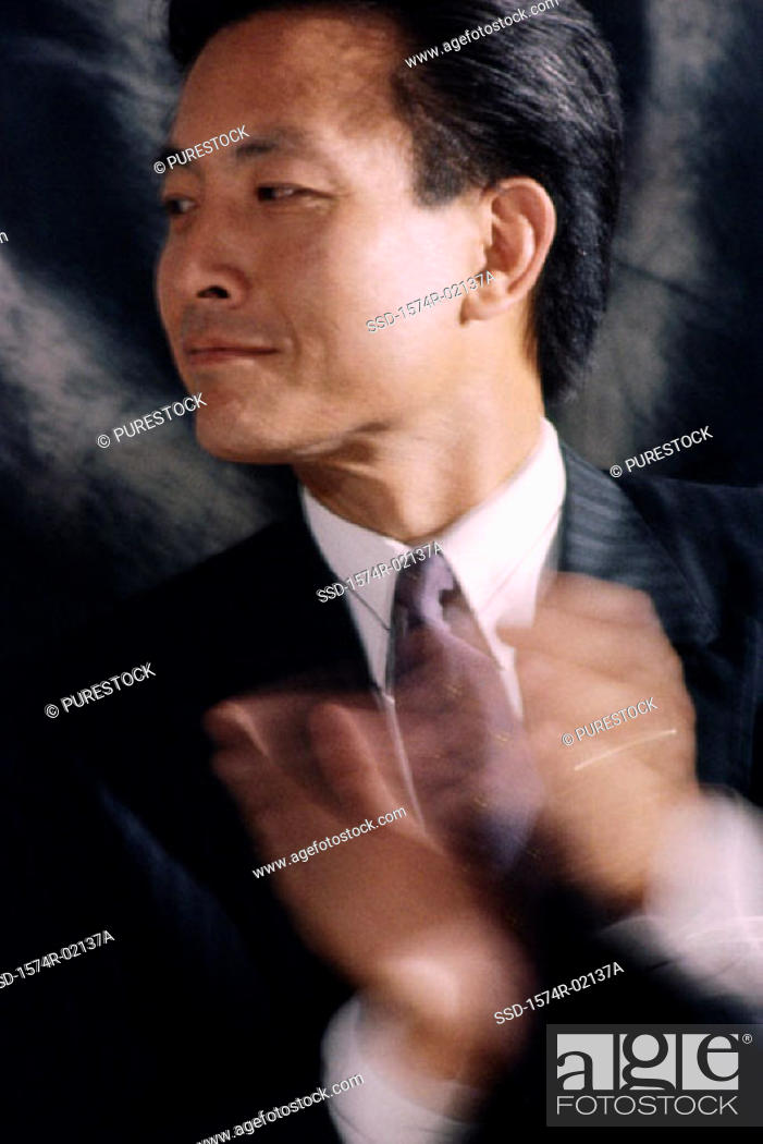 Stock Photo: Close-up of a businessman clapping.