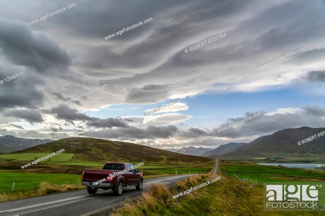 Stock Photo: Pickup truck traveling on a road in the mountains; Iceland.