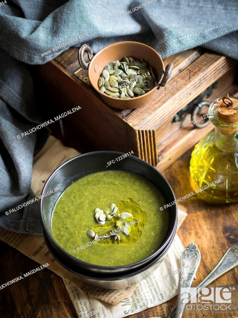 Stock Photo: Spinach sweet potato cream soup on a wooden background.