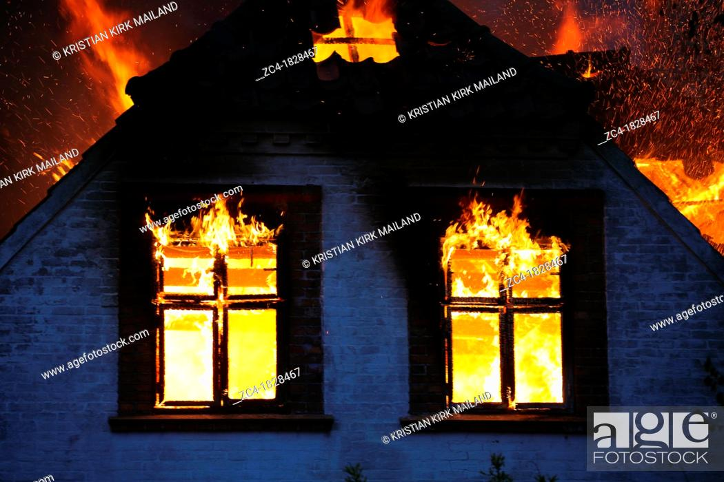 Stock Photo: House on fire.
