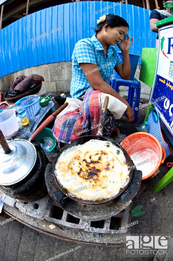 Stock Photo: Woman making pancakes  in Yangon, myanmar.
