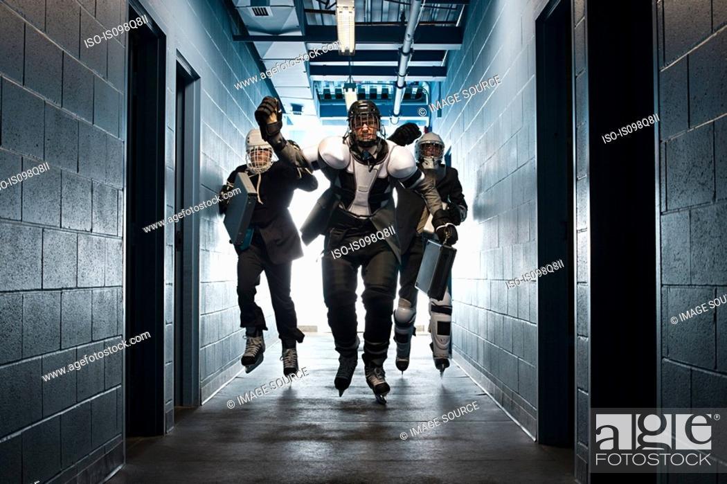 Stock Photo: Three businessmen wearing ice hockey uniforms.
