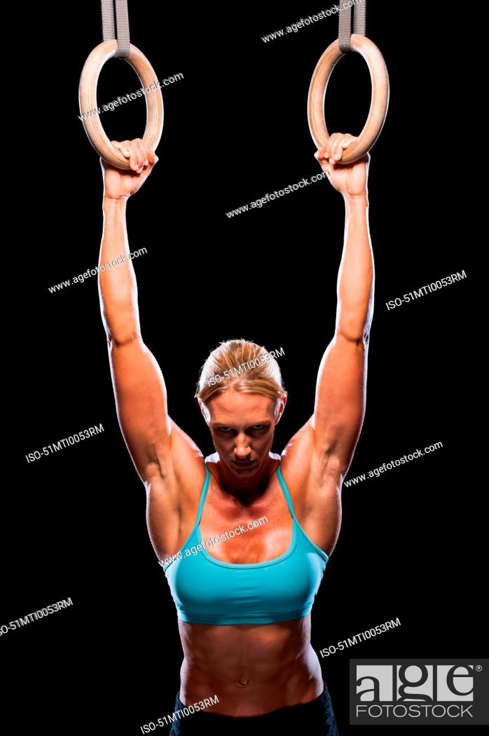 Stock Photo: Woman using exercise rings.