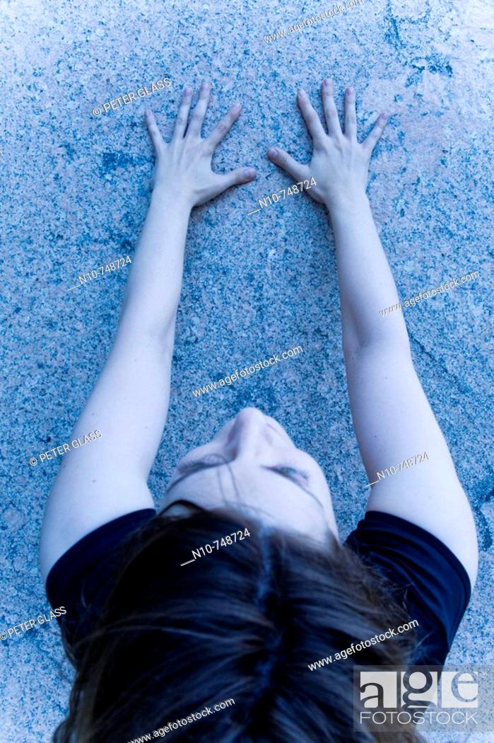 Stock Photo: Close-up of a young woman facing a wall.