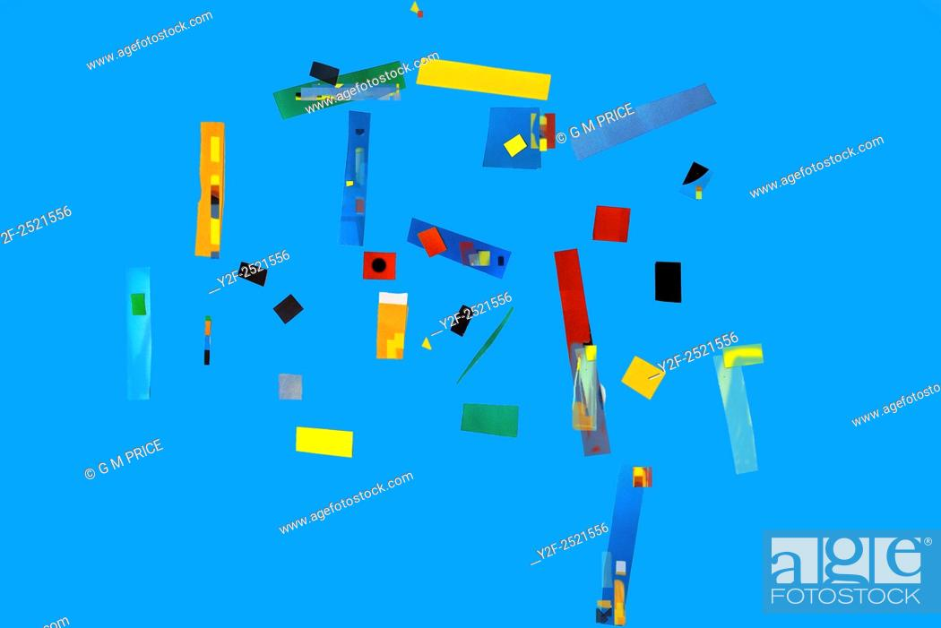 Stock Photo: scattered, colourful collage shapes against blue sky colour.