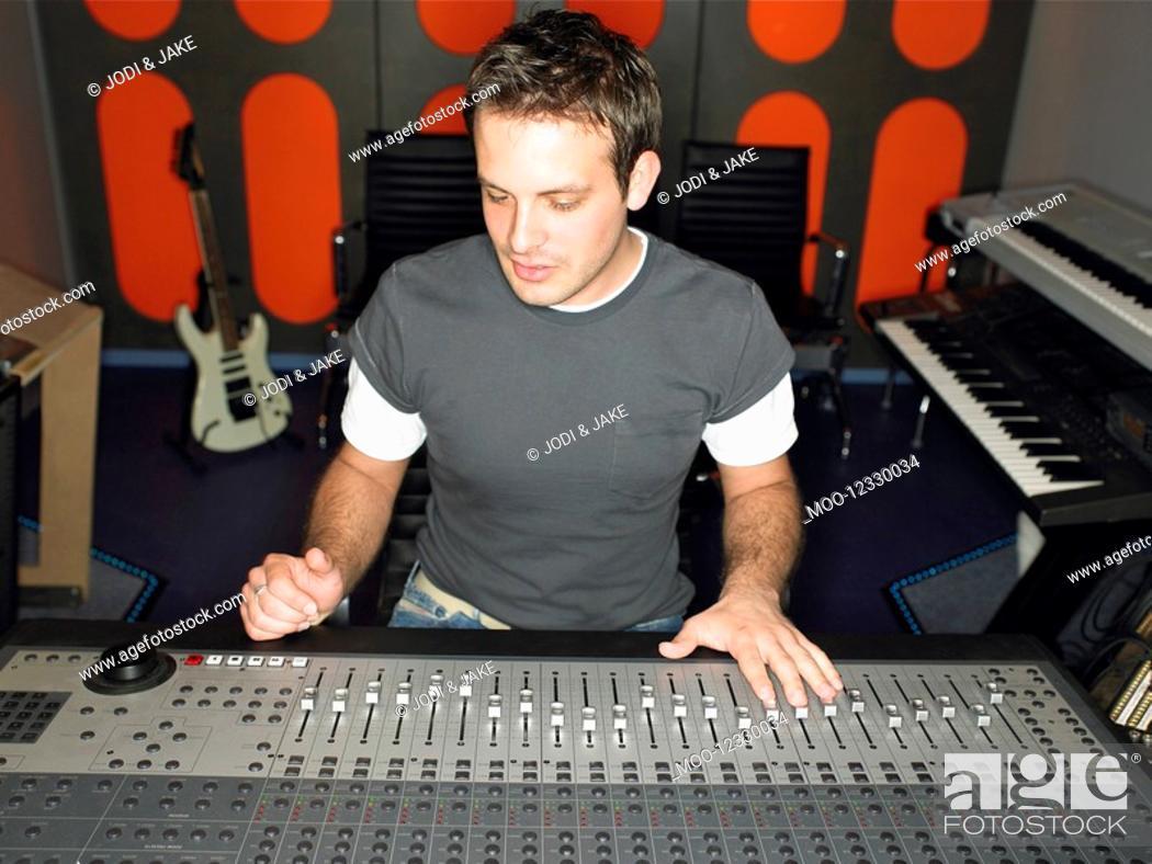 Stock Photo: Sound technician in recording studio portrait.