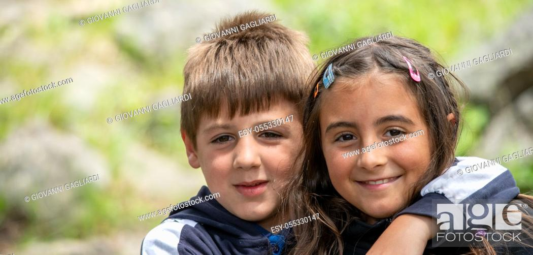 Photo de stock: Young children outdoor. Happy brother and sister in the park.