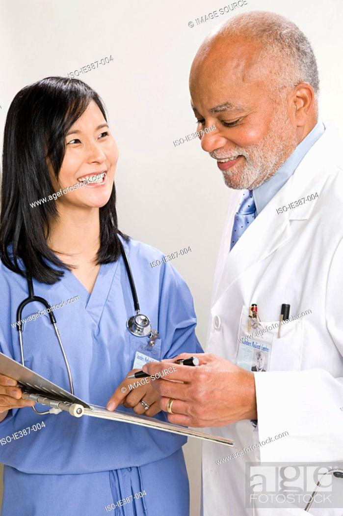 Stock Photo: A doctor and nurse.