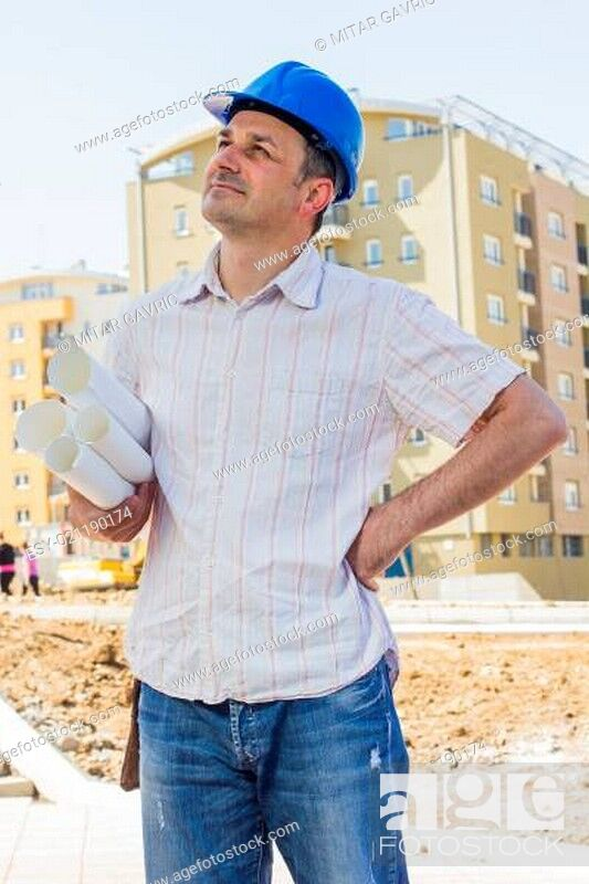Stock Photo: Construction manager holding project on site.