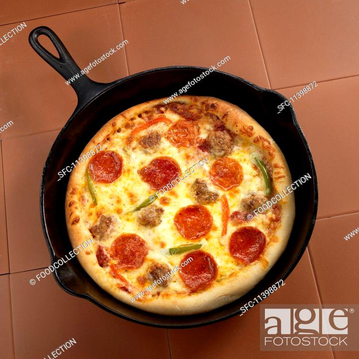 Stock Photo: A pan pizza with sausage and peppers.