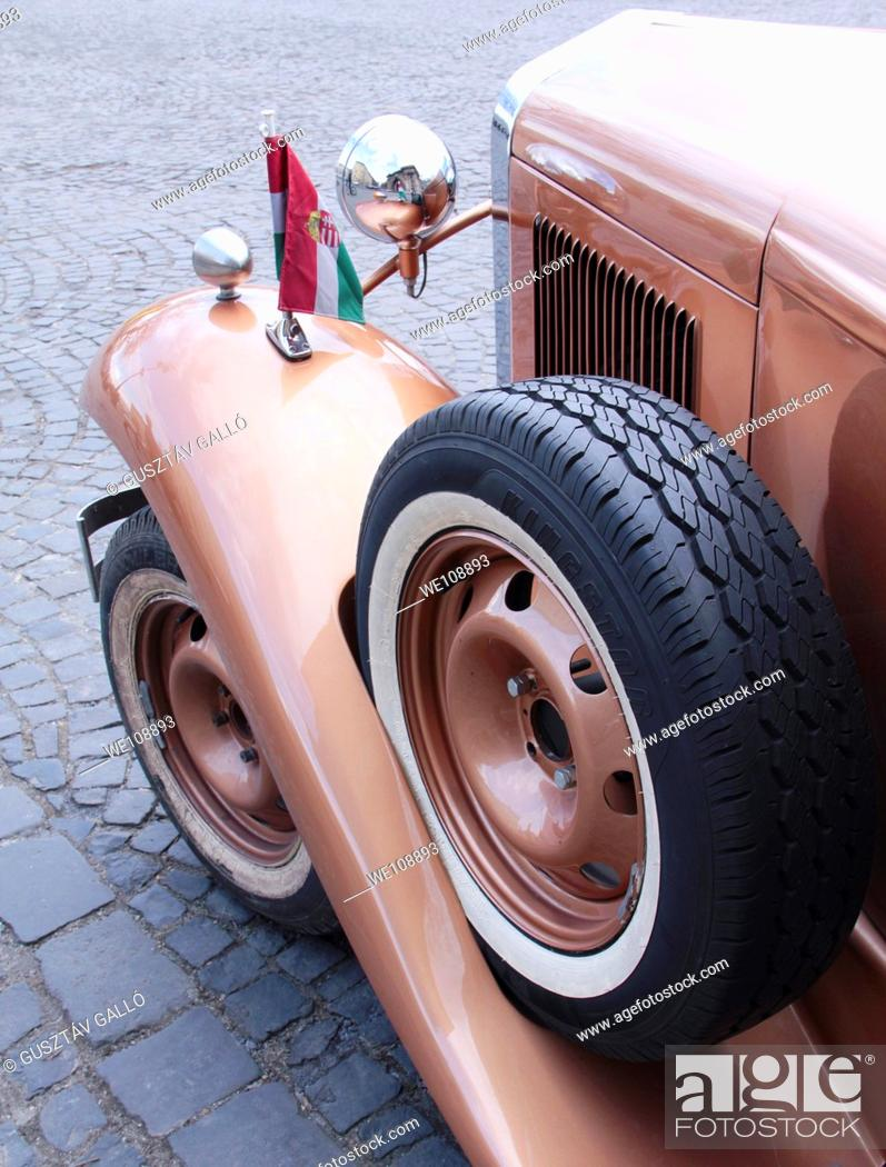 Stock Photo: old car with spare wheel.