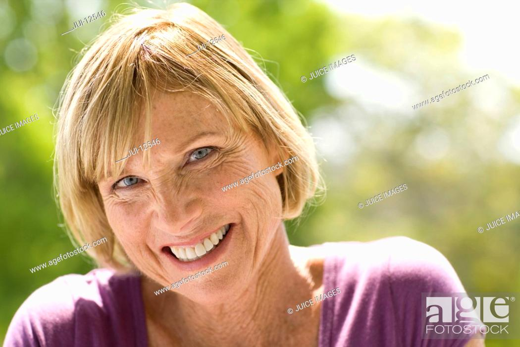 Stock Photo: Mature woman outdoors, smiling, portrait.