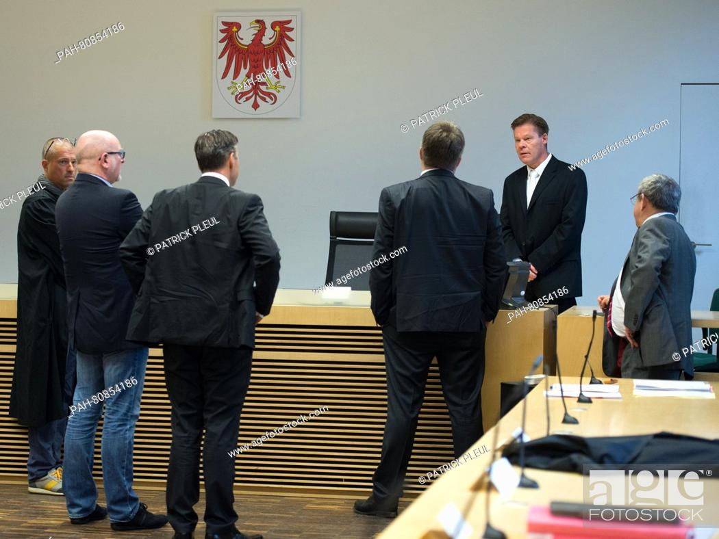 d55ed1f04647a Stock Photo - Lawyers converse ahead of trial in the courtroom of the  district court in Frankfurt (Oder)