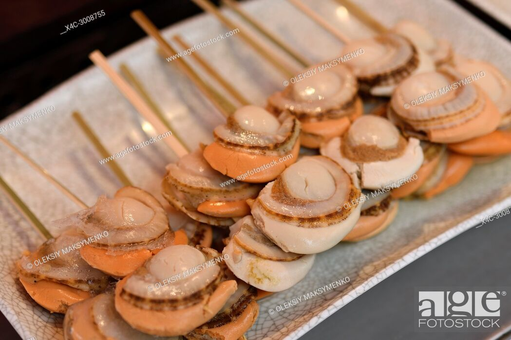 Stock Photo: Japanese street food, grilled scallops, Hotate-yaki, on a stick in Kyoto, Japan.