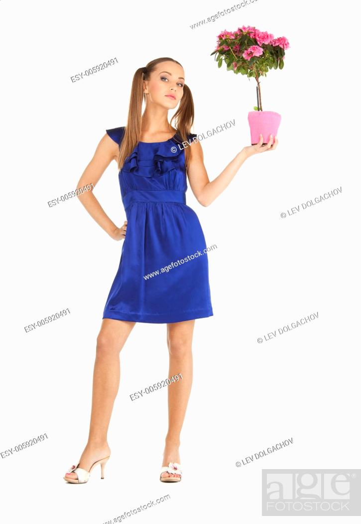 Stock Photo: bright picture of lovely housewife with flower.