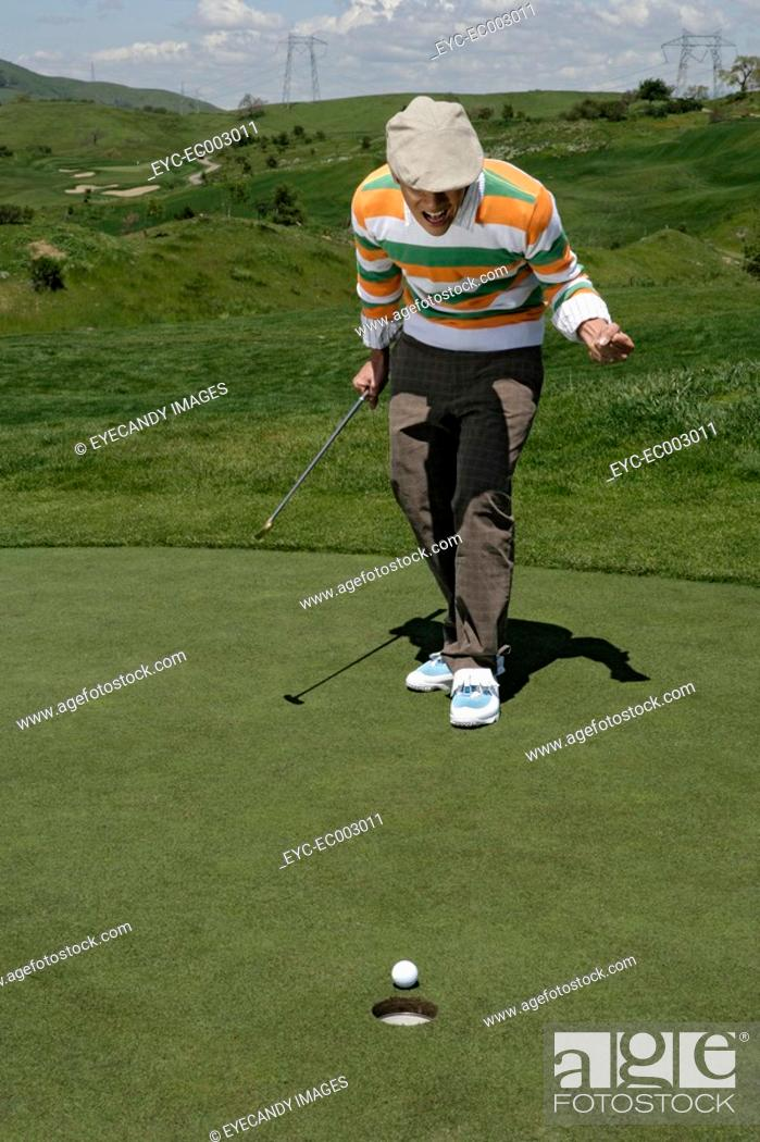 Stock Photo: Young golfer watching his ball.