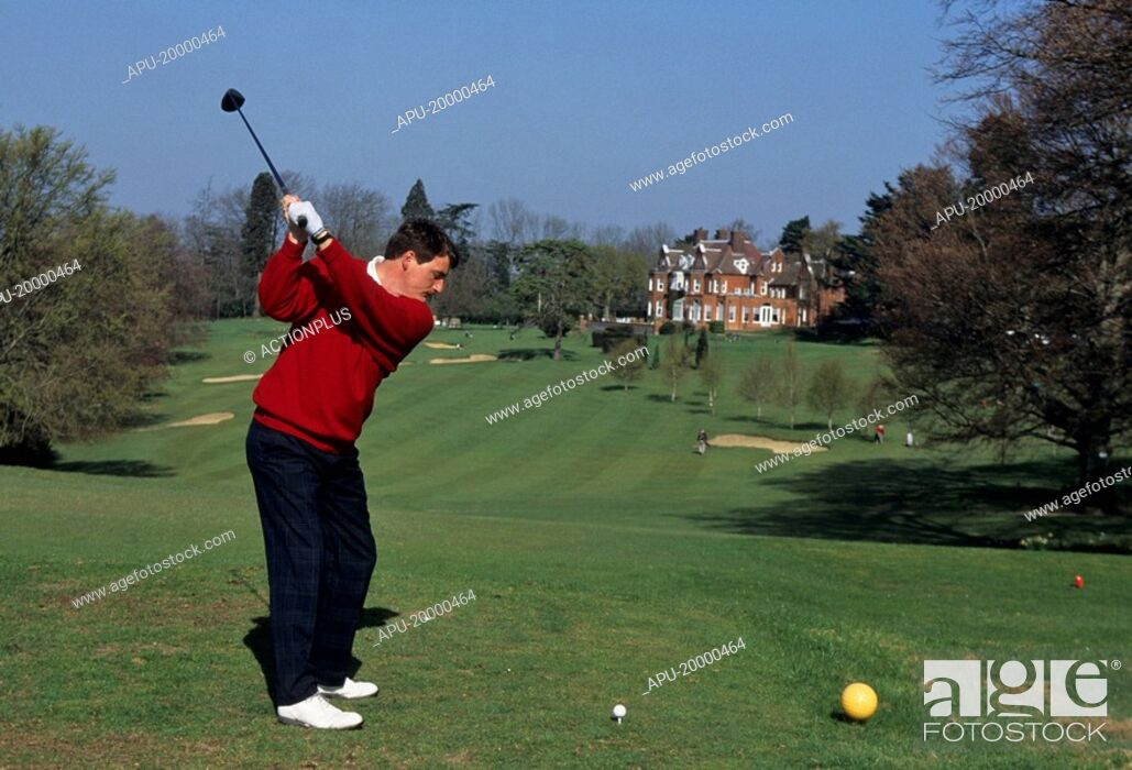 Stock Photo: Golfer tees off on a golf course.