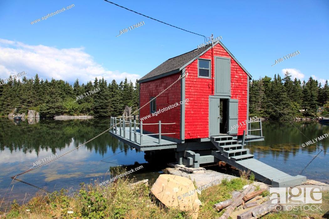 Stock Photo: red fish shack on water near world heritage city of Lunenburg, Mahone Bay, Nova Scotia, Canada, North America.