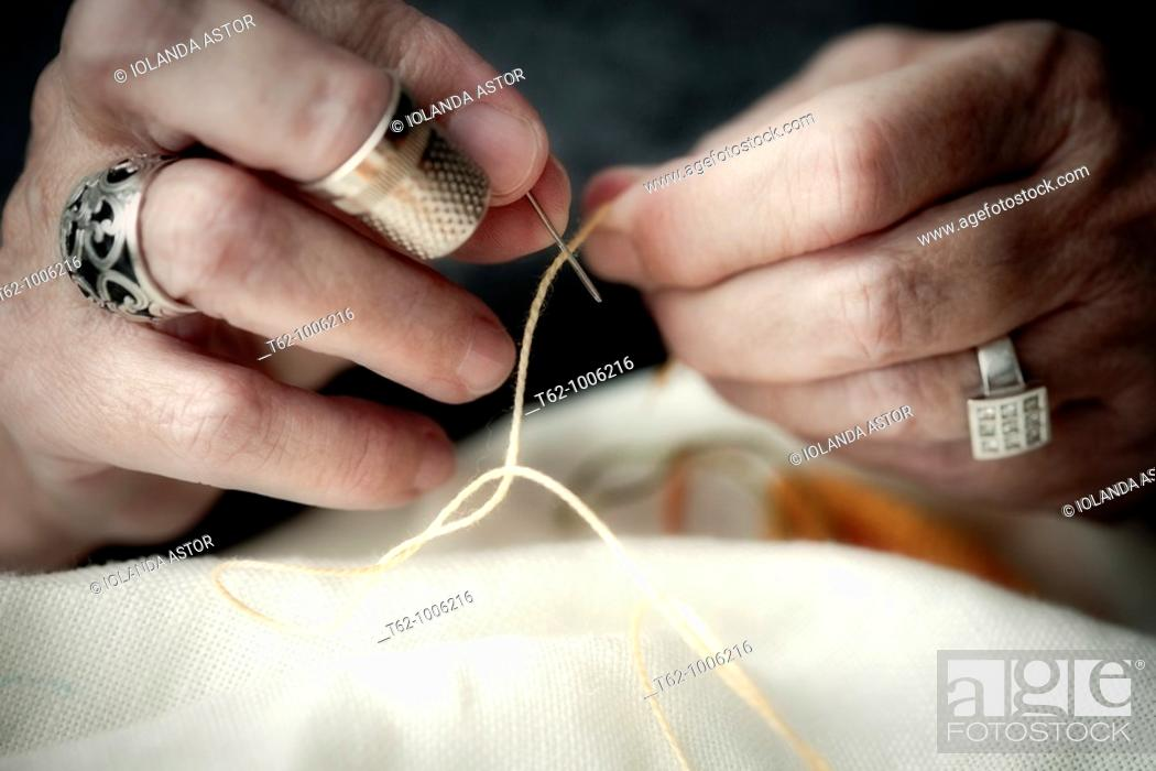Stock Photo: Handicraft  Cross-stitch work  Good linen  Close.