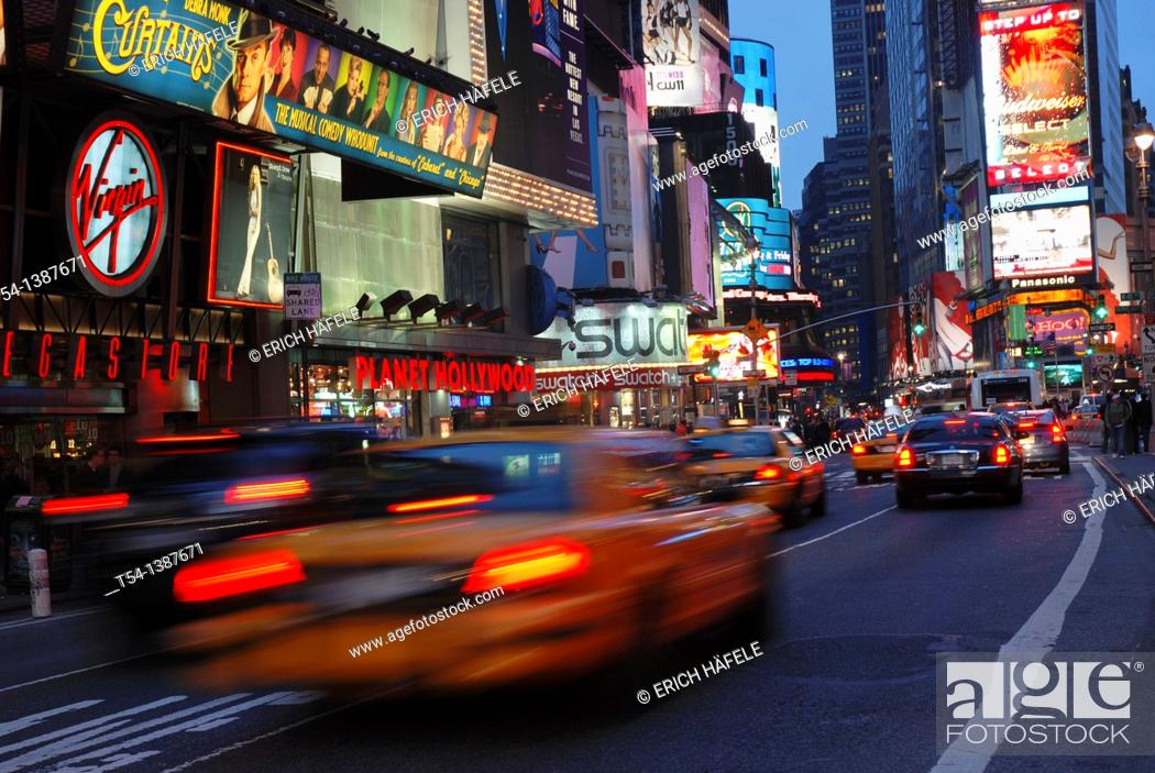 Stock Photo: Driving yellow Cabs in the Evening at Time Square in New York.