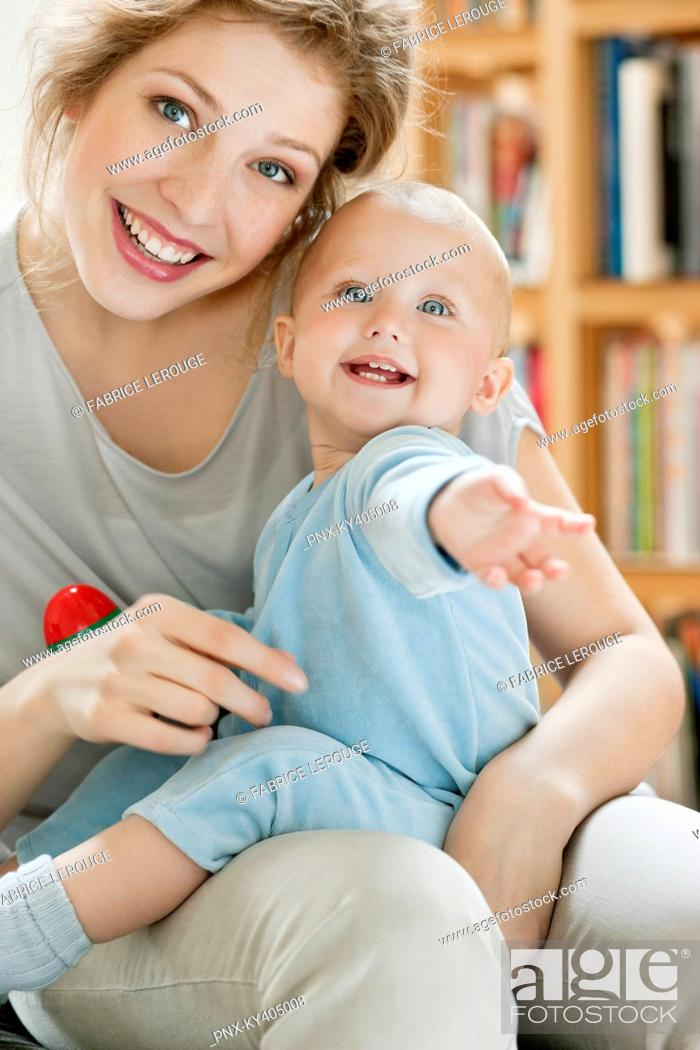 Stock Photo: Portrait of a woman playing with her daughter.