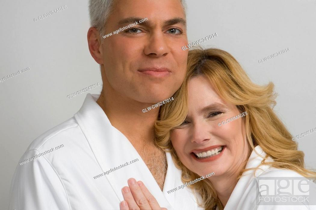 Stock Photo: Portrait of a mature couple embracing each other and smiling.