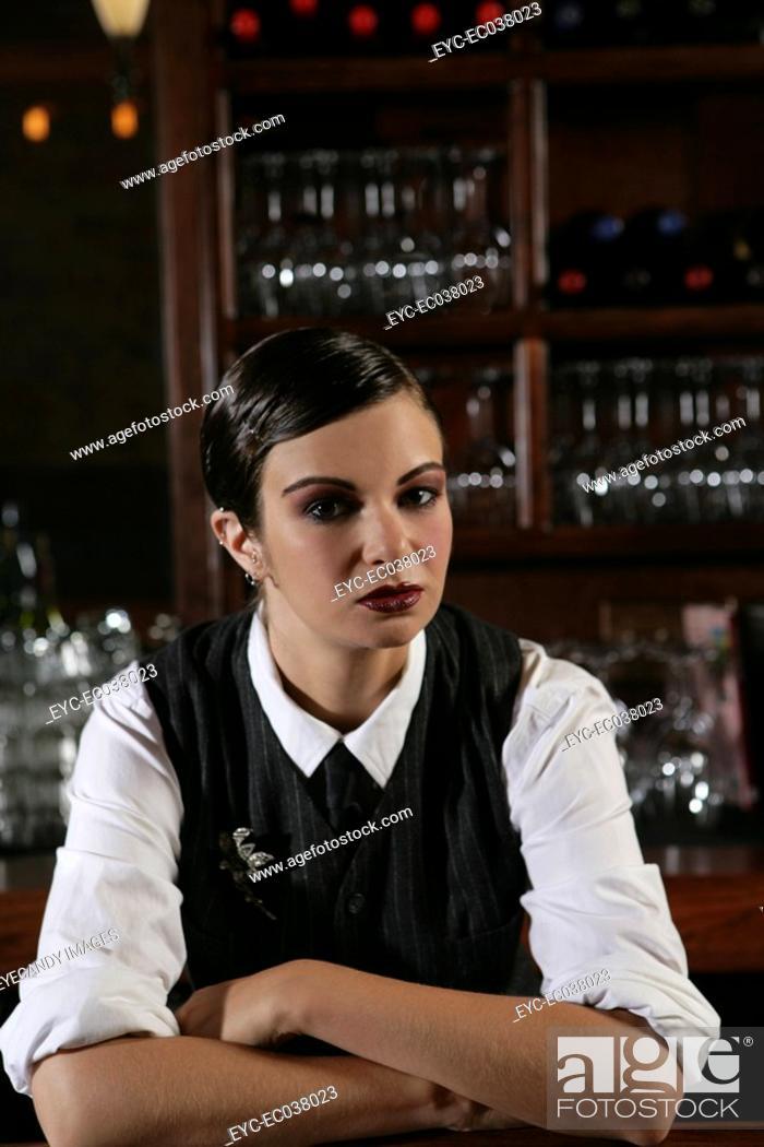 Stock Photo: Young bartender in burlesque bar.