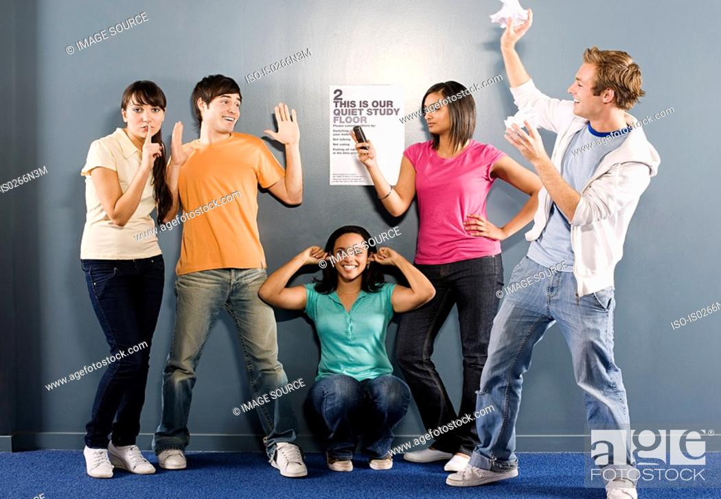 Stock Photo: Students messing around in corridor.