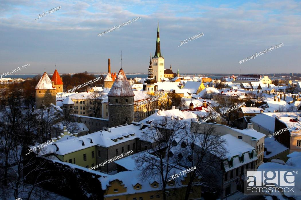 Stock Photo: Snowy roofs and St Olaf church in Talin's old town  Christmas in Tallin Estonia.