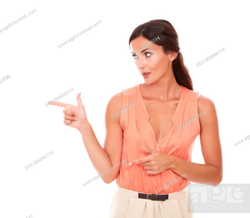 Stock Photo: Fashionable lady pointing to her right and looking to her right in white background - copyspace.