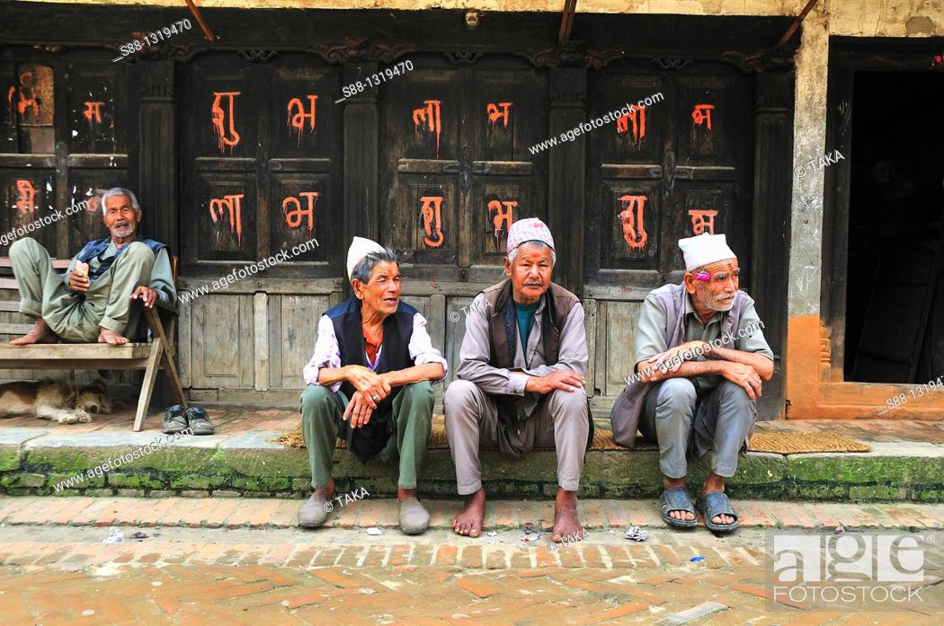 Stock Photo: Old friends sitt together, Bhaktapur Bhadgaon Kathmandu valley Nepali.
