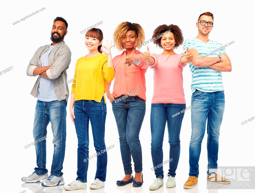 Stock Photo: diversity, race, ethnicity and people concept - international group of happy smiling men and women over white background.