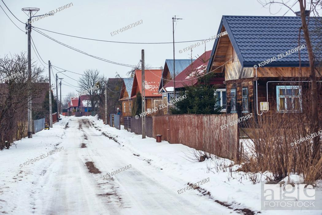 Stock Photo: Wooden houses along road in Soce village on so called Land of Open Shutters trail, famous for traditional architecture in Podlaskie Province, Poland.