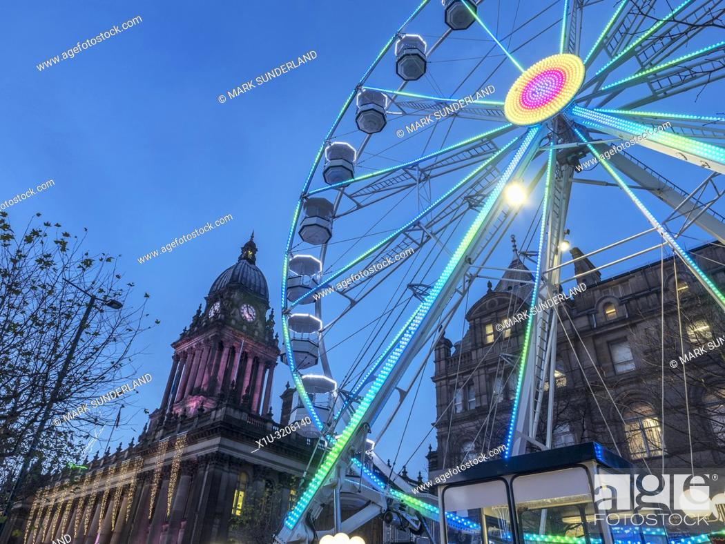 Stock Photo: Leeds Wheel of Light illuminated at dusk at Christmas on The Headrow in Leeds West Yorkshire England.