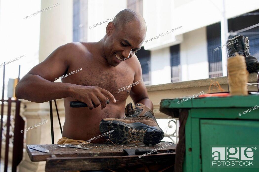 Stock Photo: Cuba, Santiago de Cuba, cobbler at work.