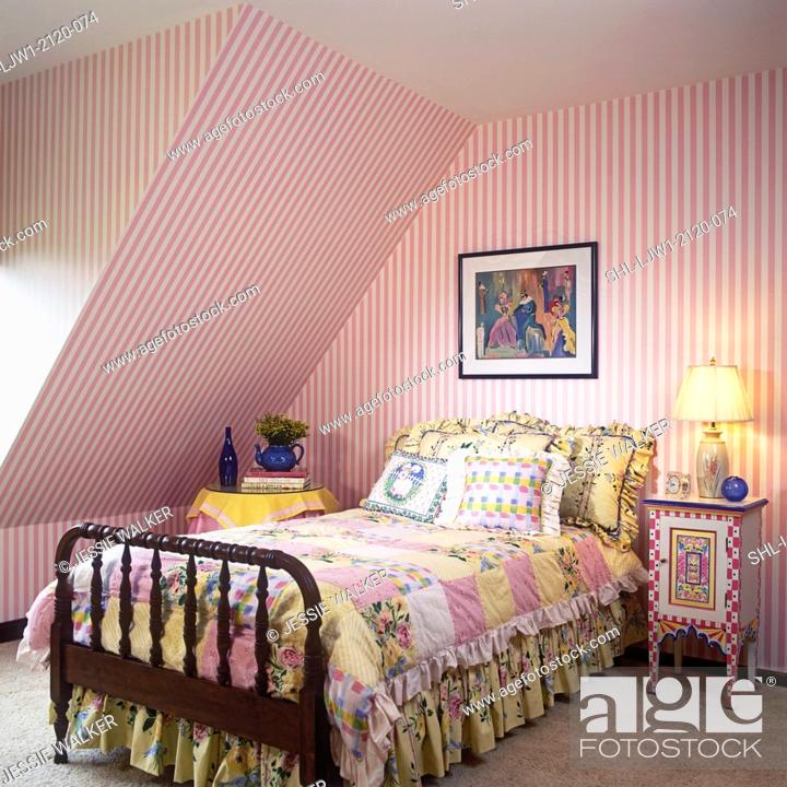 Stock Photo Children S Bedroom Pink Stripe Wallpaper Upstairs Colorful Hand Painted Side Table Bed Clothes Are Multi Colors Of Cream