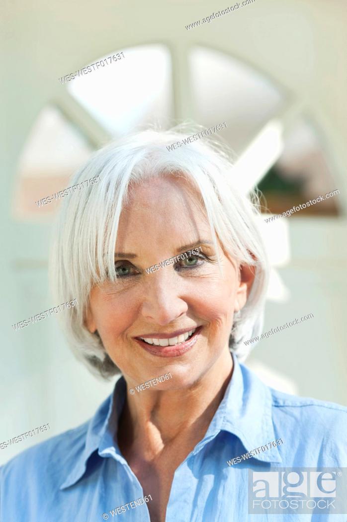 Stock Photo: Germany, Bavaria, Senior woman smiling, portrait.