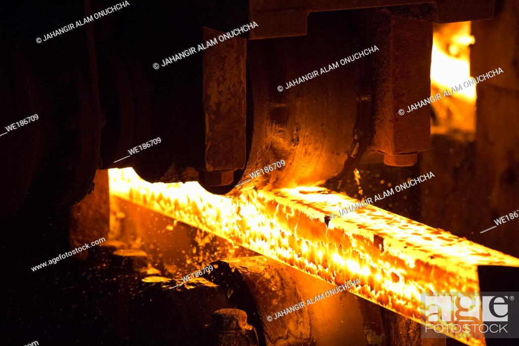 Stock Photo: Steel slab being rolled on the Hot strip mill at Demra, Dhaka, Bangladesh.