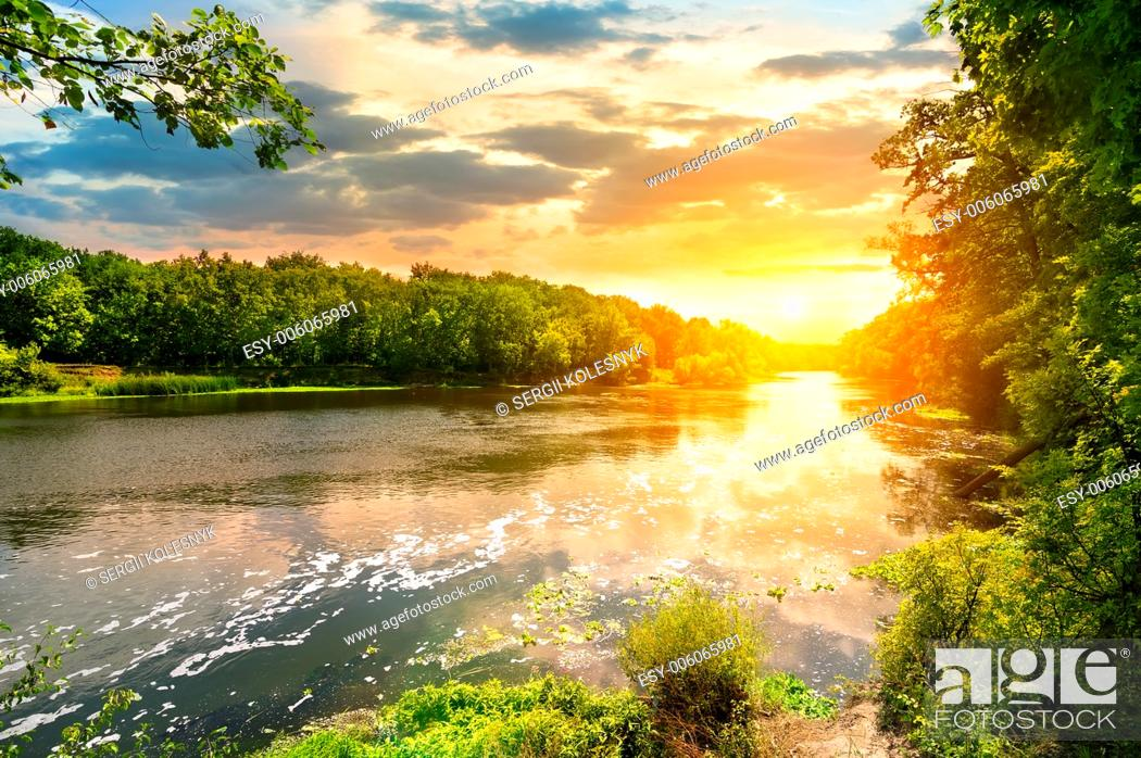 Stock Photo: Sunset over the river Severskiy Donets in the forest.