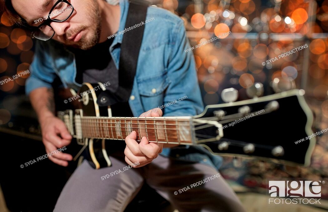 Stock Photo: musician playing guitar at studio or music concert.