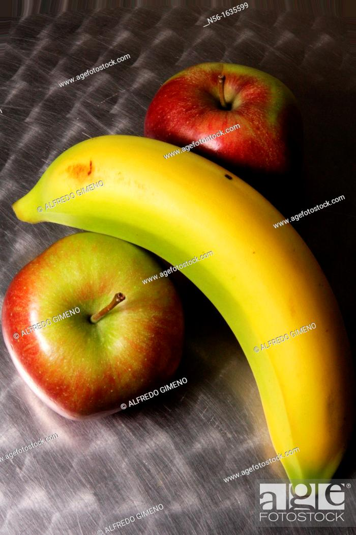 Stock Photo: BANANA AND APPLES.