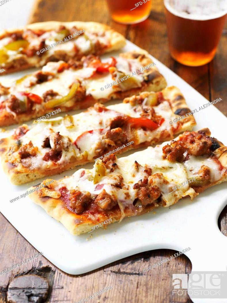 Stock Photo: Pieces of pizza topped with sausage and peppers.
