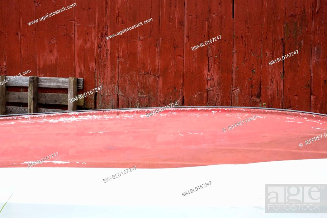Stock Photo: Rowboat stored upside-down at shack.