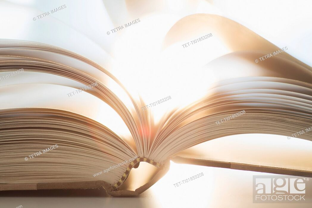 Stock Photo: Book on table.