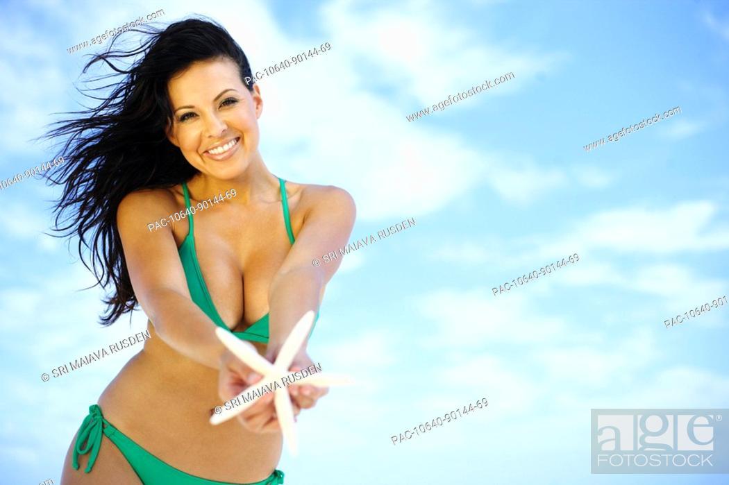 Stock Photo: Hawaii, Oahu, beautiful woman posing on the beach.