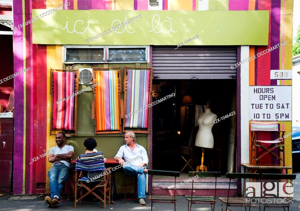 Stock Photo: People having a chat out of a vintage shop, Surry Hills area, Sydney, Australia.