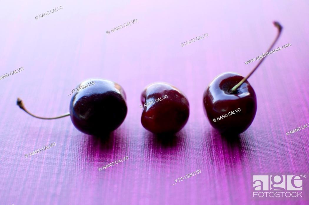 Stock Photo: Still Food: Three Cherries.